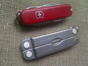 Vitorinox Swiss Army Knife and a Leatherman Micra - both essentail kit to own