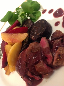 Winterbourne Game, pigeon with black pudding served with beetroot, apple, pea shoots and citrus salad.